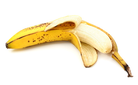 overripe: Half-peeled overripe, spotty banana, isolated on a white background