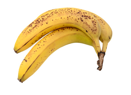 overripe: Three overripe bananas with brown spots, isolated on a white background Stock Photo