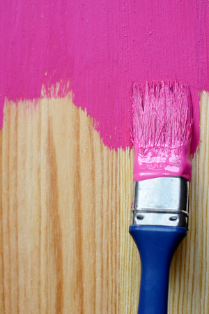 bright colour: Closeup of pine plank being painted in a bright colour, with copy space