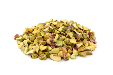 Chopped pistachio nuts, isolated on a white background