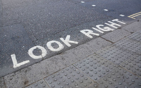 look at right: Look Right - painted instruction on the road at a pedestrian crossing
