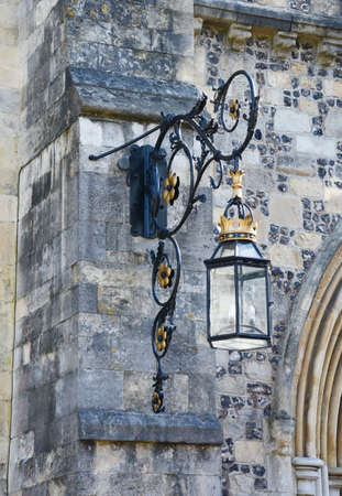 great hall: An ornate lantern on the stone exterior of the Great Hall in Winchester, England Stock Photo