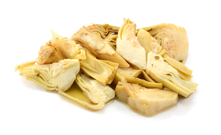 Heap of artichoke heart slices in olive oil and herbs, isolated on a white background photo