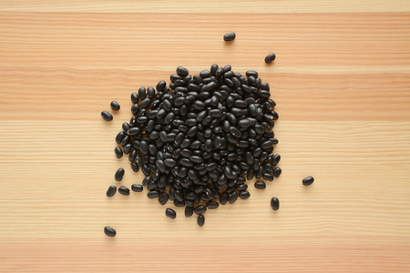 turtle bean: Black turtle beans on a wood background