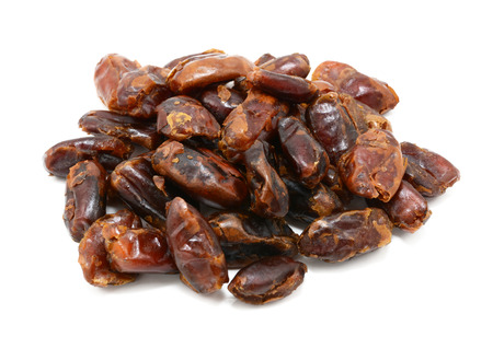 pitted: Sticky whole dates, isolated on a white background
