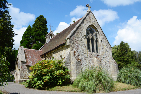 Small stone chapel in the village of Lyndhurst in the New Forest in the summer time