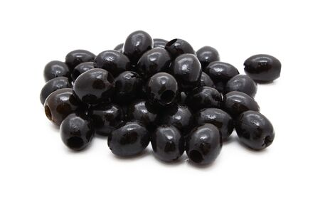 pitted: Pitted black olives in oil, isolated on a white background Stock Photo