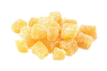 Cubes of crystallised stem ginger, isolated on a white background