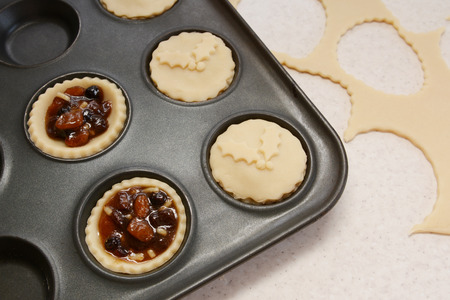 mincemeat: Process of making mince pies with pastry and traditional mincemeat filling