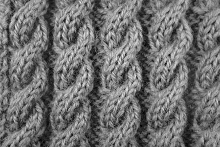 knitting: Close up of coiled rope cable knitting stitch - monochrome processing Stock Photo