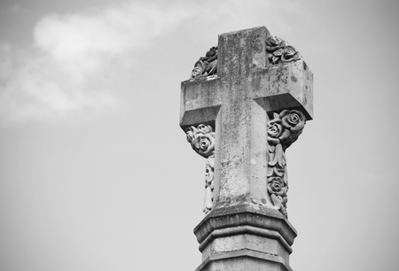 winchester: Detail of stone cross war memorial outside Winchester Cathedral, England - monochrome processing