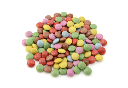 sugarcoated: Colourful sugar-coated chocolate beans, isolated on a white background