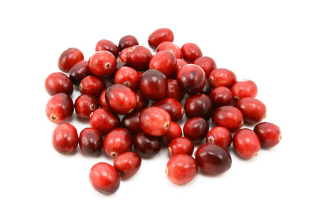 Whole fresh cranberries, isolated on a white background photo