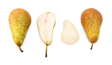 Conference pears - whole, halved and peeled, isolated on a white background photo