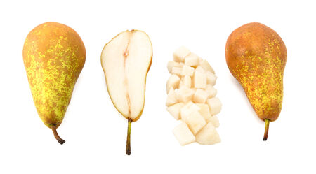 Conference pears - whole, halved and diced, isolated on a white background