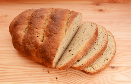 malted: Freshly cut slices of seeded bread fanned out from a new loaf