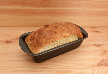crust crusty: Fresh from the oven - a loaf of oat and linseed bread in the tin