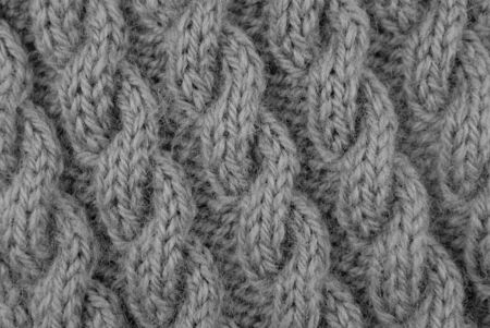 cable stitch: Closeup of coiled rope cable stitch knitting on the diagonal - monochrome processing