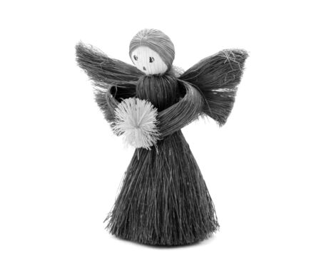angel tree: Christmas Angel tree decoration made from straw, isolated on a white background - monochrome processing