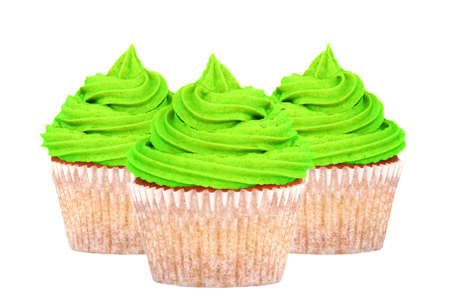 17th of march: Three cupcakes with bright green frosting for St Patricks Day, isolated on a white background Stock Photo