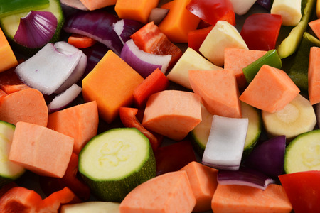 butternut squash: Chopped vegetables as an abstract background - red onion, sweet potato, courgette, green pepper, red pepper, parsnip and butternut squash Stock Photo
