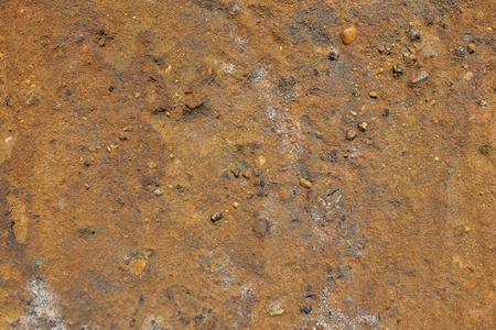 gritty: Gritty golden brown sandstone abstract background texture with small stones Stock Photo