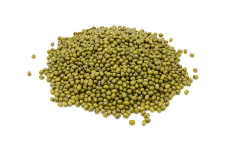 moong: Dried green mung beans, isolated on a white background