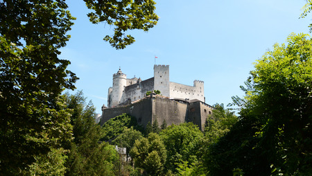 framed: View of the Festung Hohensalzburg framed by lush green trees on summer day in Salzburg, Austria, Europe Stock Photo