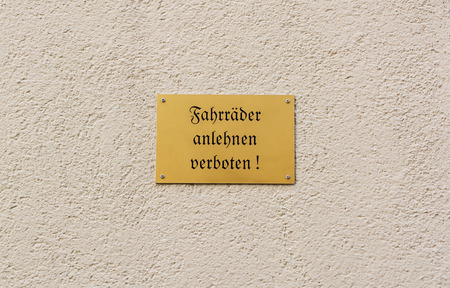 forbids: German sign on rendered wall forbids people to lean their bikes against the building - Fahrraeder anlehnen verboten! Editorial