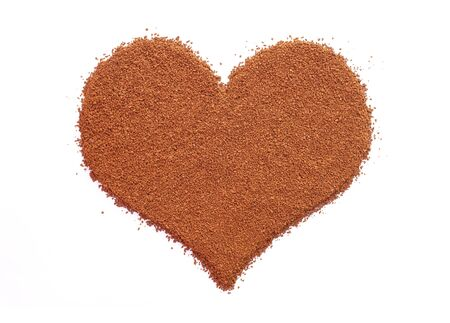 instant coffee: Instant coffee granules in a heart shape, isolated on a white background Archivio Fotografico