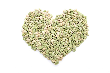 common bean: Flageolet beans in a heart shape, isolated on a white background