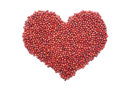 aduki bean: Red adzuki beans in a heart shape, isolated on a white background