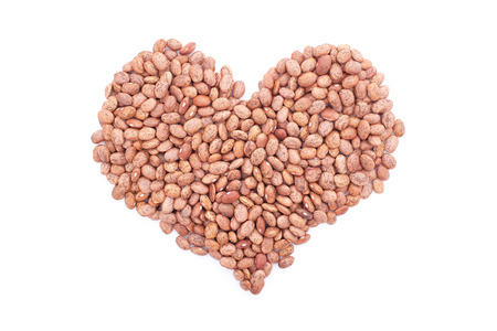 pinto bean: Pinto beans in a heart shape, isolated on a white background
