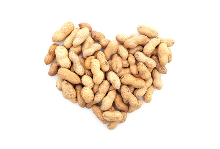 monkey nuts: Monkey nuts in a heart shape, isolated on a white background