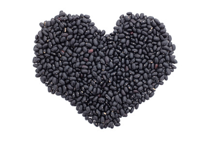 turtle bean: Black turtle beans in a heart shape, isolated on a white background Stock Photo