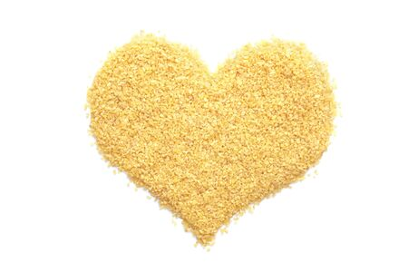 dalia: Bulgur wheat in a heart shape, isolated on a white background Stock Photo