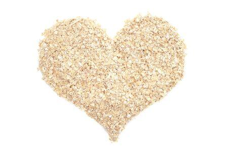 Porridge oats in a heart shape, isolated on a white background 版權商用圖片