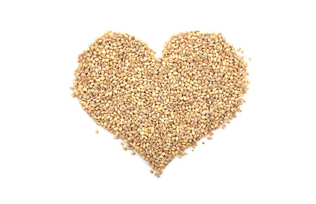 pearl barley: Pearl barley in a heart shape, isolated on a white background