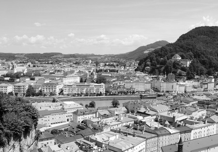 salzach: View across the European city of Salzburg in Austria. Looking east over the Salzach river to Elisabethkai and the cityscape beyond - monochrome processing.