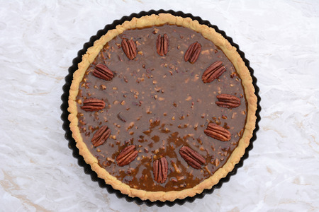 pecan pie: Pecan pie decorated with toasted nuts ready to be baked in the oven Foto de archivo