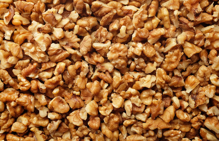Pieces of chopped walnut as an abstract background texture