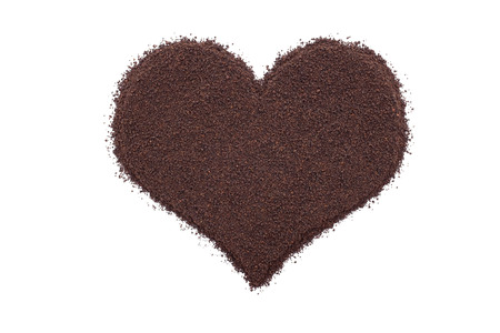 loose leaf: Loose leaf tea in a heart shape, isolated on a white background