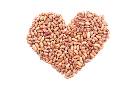 borlotti beans: Cranberry beans, or borlotti beans in a heart shape, isolated on a white background Stock Photo