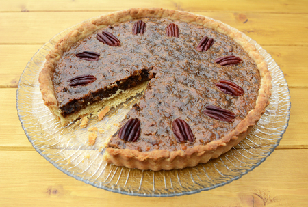are taken: Traditional pecan pie on a glass plate with one slice taken