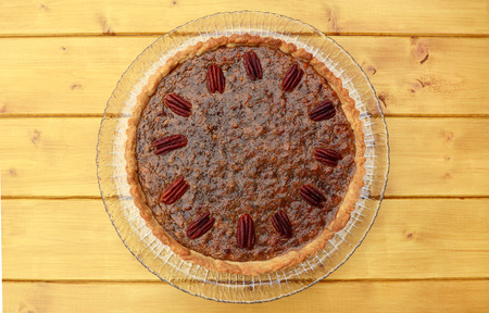 pecan pie: Freshly baked home-made pecan pie on a wooden table Foto de archivo
