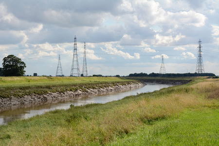foul: Overhead power lines span the River Nene at Foul Anchor, Cambridgeshire, carrying electricity from Sutton Bridge power station.