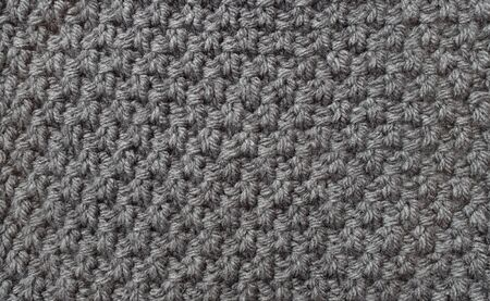 abstract seed: Seed stitch in grey yarn as an abstract background texture