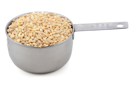 pearl barley: Pearl barley in an American measuring cup, isolated on a white background