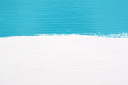 blue stripe: Horizontal stripe of teal paint over white painted wooden background