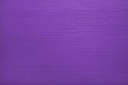 painted wood: Pine plank painted purple, wood grain pattern shows through